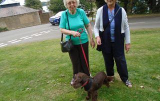 Trustees Ann and Deanna with Daisy who Ann adopted earlier in the year