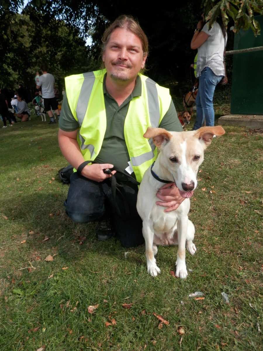 Staff member Robert with resident Cassie waiting for her forever home