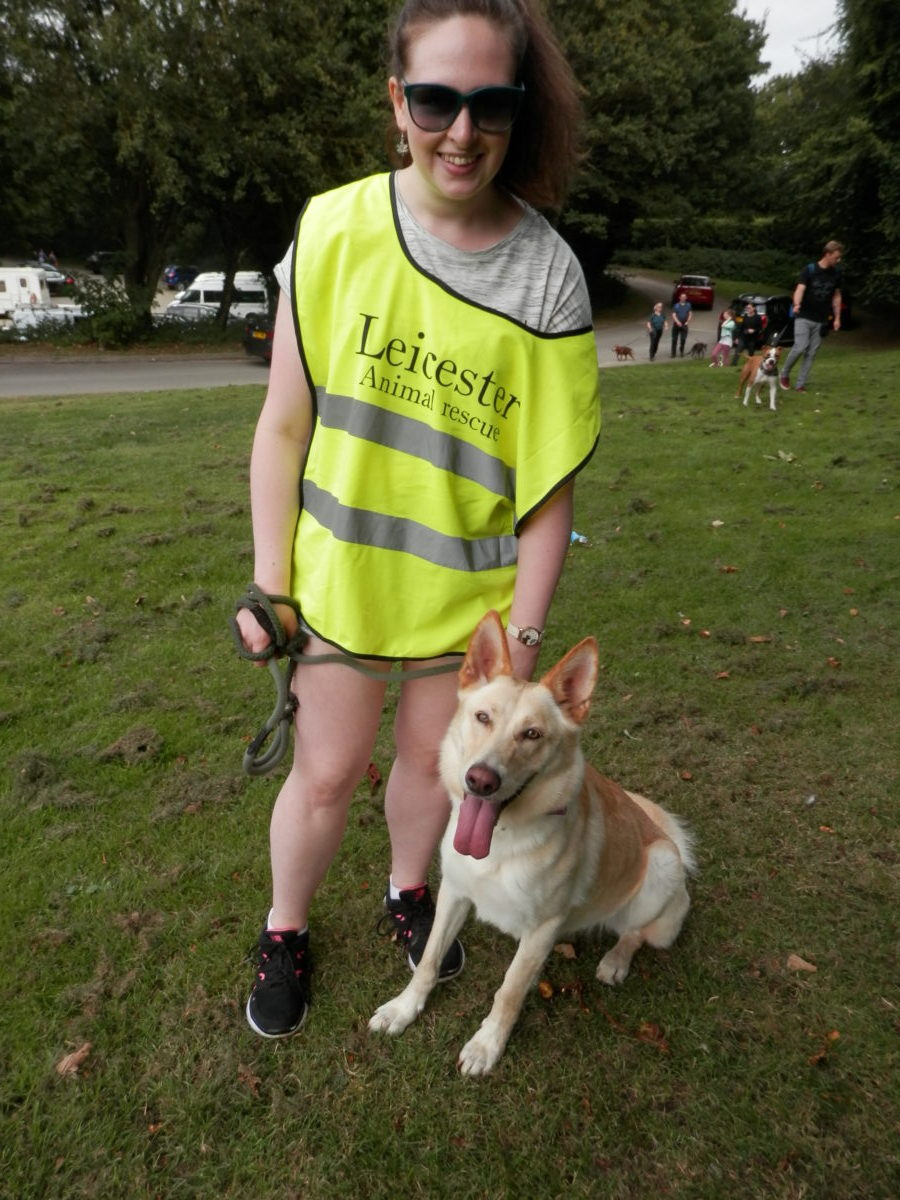 Volunteer Kelly with resident Goldie who is reserved